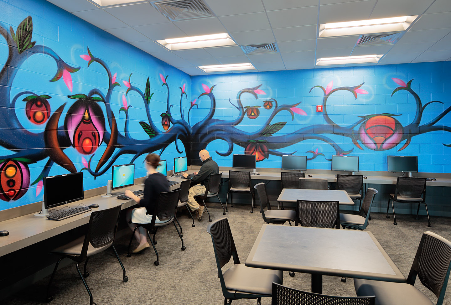 Above: The public computer room is open to local schoolchildren, families and community members without internet access or computers at home. The lab features artwork by ArtsTech's Aaron Sutton.