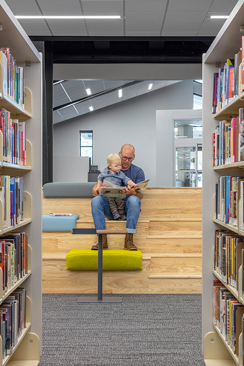 Dad with son at library